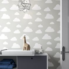 East Urban Home These grey skies are anything but gloomy. Fluffy clouds float along in a peaceful and happy dance. The perfect grey wallpaper for a gender neutral nursery. Geometric Wallpaper Murals, Grey Wallpaper, Kids Wallpaper, Wallpaper Roll, Peel And Stick Wallpaper, Grey Cloud Wallpaper Nursery, Clouds Nursery, Star Nursery, Nursery Room