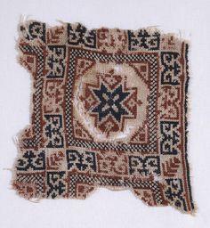 Textile fragment with star and pseudo-inscription. Egypt, Mamluk Period (1250 - 1517). Ashmolean Museum, University of Oxford.