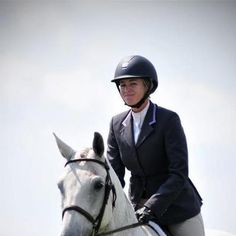 Hayward sponsored rider Ryan Roy is wearing our machine washable 1/2 ribbon jacket with light purple collar accents. She is also wearing a white snap collar show shirt with purple trim.