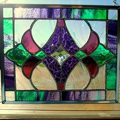 Purple, orchid and green stained glass panel