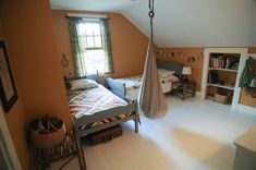 Shared boy bedroom - quilts, baskets, fabric bunting, Anna Maria Horner voile fabric curtains, hanging chair (IKEA?)