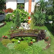 outdoor design ideas kichler garden design with beautiful garden in the backyard with gorgeous flowers and shade trees also a small pond with wooden bridge
