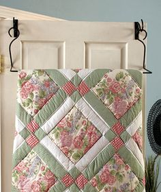 The site is for the hanger, but i like the quilt using a large print