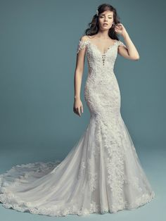 ba96e1fcbd30 Della by Maggie Sottero Beaded lace motifs and Swarovski crystals cascade  over tulle in this fit · Mermaid Wedding