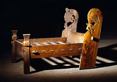 Wooden Viking bed with carved dragon headboard, 8th century -- discovered in the Oseberg burial Photo: Museum of Cultural History, University of Oslo, Norway