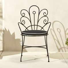 Shop peacock chair with cushion.   Fanciful perch designed by Ayush Kasliwal brings a refined vintage vibe to the patio.  Handmade solid iron with black glossy powdercoat achieves the perfect curves through a manual hand-bending process.