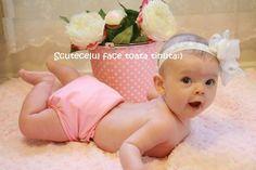 Cauti o tinuta potrivita pentru bebe pentru pozele de familie?