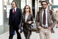 Perms, tans, glitter, plunging necklines—there's no question that the disco-era looks in American Hustle deserve their own trophies this award season.