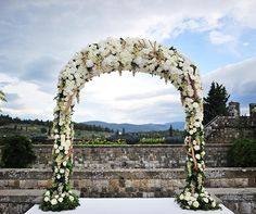 This wedding arch is dripping in fresh, local red and green grapes.