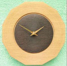 wooden wall clock 13 oak with burned center       http://www.steve-t.co.uk/wooden_wall_clock_13.html