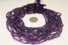 1strand  natural amethyst plain oval sized 7 by 9mm by 3yes