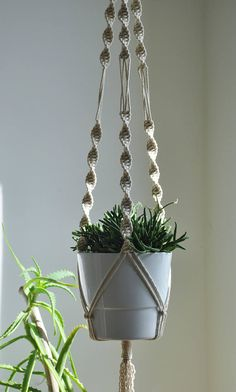 Natural cotton rope macrame plant hanger. Minimalistic and still very decorative.  Great hanging plant holder for an indoor garden. Will fit perfectly with boho home decor or more simple, scandinavian interiors. READY TO SHIP  >> color: natural cotton/ecru/beige  >> measurements:  white pot diameter 16cm (6,2 in) height 14 cm (5,5 in)  +/- couple centimeters smaller pots will also fit with no problem, slightly larger also but if you have much bigger pot ask for cust...