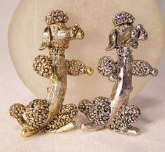 •Vintage pair of sitting up Poodle pins, each signed Gerrys  •One silver tone, one gold tone  •1.5 tall, very detailed, wear together or alone