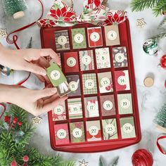 This DIY Christmas advent calendar is made from a dollar store cookie sheet and matchboxes covered in Christmas paper. Fill the boxes with little candy bars or put papers ins Christmas Paper Crafts, Christmas Activities, Christmas Projects, Holiday Crafts, Christmas Diy, Christmas Decorations, Christmas Tables, Modern Christmas, Scandinavian Christmas