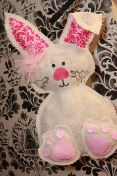 Easter bunny burlap door hanger  white by Cutipiethis on Etsy   #spring #pastels #easter #easterdecor #homedecor #holidaydecor #homeholidaydecor #easterideas #pretty #homedecorating www.gmichaelsalon.com #bunnies #chicks #eggs #eastereggs
