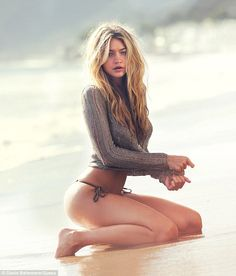 Beach attire: Gigi modelled another string bikini with a taupe knit top...