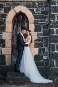 Romantic wedding dress with tulle skirt and train   Emma Wise Photography