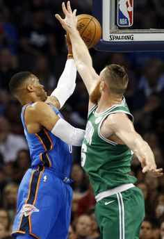 Oklahoma City's Russell Westbrook (0) shoots as Boston's Aron Baynes (46) defends in the first quarter during an NBA basketball game between the Oklahoma City Thunder and the Boston Celtics at Chesapeake Energy Arena in Oklahoma City, Friday, Nov. 3, 2017. Photo by Nate Billings, The Oklahoman