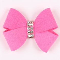 Put a bow on your little bundle of joy with this adorable dog hair bow! The perfect pink dog hair bow designed by Susan Lanci features her oversized Nouveau bow with two rows of sparkling Swarovski crystals for the cutest style on the block. Susan Lanci's