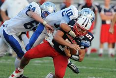 Lebanon Mark Pyles is sacked by Cedar Crest's Grant Boehler (10) and Devin Edwards (64) during the first half of 41st annual Cedar Bowl at Alumni Stadium on August 31, 2012. LEBANON DAILY NEWS -JEREMY LONG