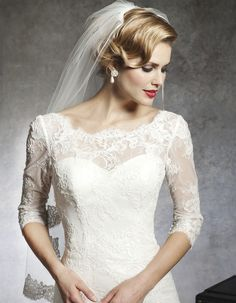 Illusion neckline on this Justin Alexander lace wedding dress style 8666  #sleeves #lace #bride