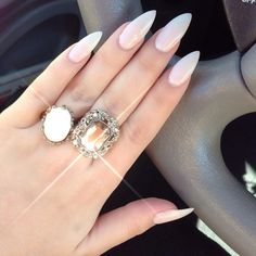Don't really like the stiletto nails, but these are pretty, classy and simple.