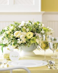 Beautiful pale yellow flowers in a white vase.