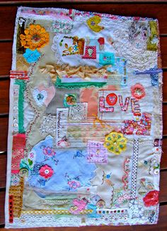 mixed media quilt - covered with bits and pieces of mementos, family photos transferred , etc...