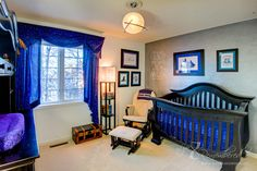 Harry Potter Nursery. I am so in love with this crib and the color of this blue
