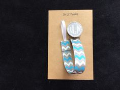 Baby Boy monogrammed pacifier clip on blue, white, and grey chevron clip.