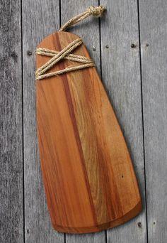 Hei toki (maori adze) serving board made from recycled rimu.