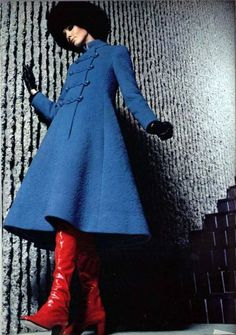 Model wearing a coat by Nina Ricci for L'officiel, 1970. Those red boots are just it.