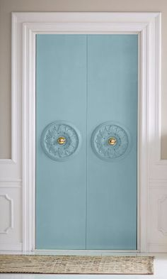 Bring some Parisian charm to closet doors with inexpensive ceiling medallions. Just nail them on and paint.