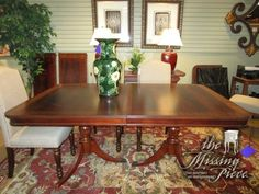 """Traditional style double pedestal base table in a two-tone medium finish with brass feet. 70""""long x 44""""wide, two 20""""leaves. This table comes with protective pads as well. Unreal price! Arrived: Thursday January 19th, 2017"""