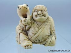 Ivory netsuke with Gamma sennin and his toad. Good Kyoto school ivory netsuke with a seated Gamma sennin with his 3 legged toad. Toads eyes inlaid in horn Kyoto school. Size 16mm high- 56mm wide. Late 18th C
