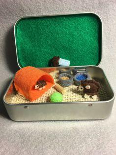 Miniature plush felt hedgehog in a tin play set https://www.etsy.com/listing/258490087/miniature-felt-plush-hedgehog-in-altoid
