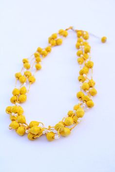 Yellow Sunshine Long 4-Strand Paper Bead Necklace w/ Earrings | Made By Kenia by LasAguasVerdes on Etsy https://www.etsy.com/listing/470150953/yellow-sunshine-long-4-strand-paper-bead