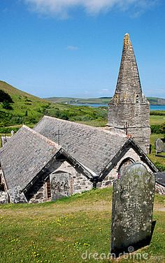 View of St Enodoc Church in Trebetherick, North Cornwall, with the River Camel in the background