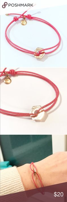 Marc by Marc Jacobs Pink Friendship Bracelet Pink cord with rose gold hardware. Note: this photographs like yellow gold but it is not. It is the rose gold color. Pink is a medium shade of pink and shows some wear. I wore this stacked with other friendship bracelets, cuffs, watches - just wanted to add a touch of feminine pink and rose gold. A touch of sparkle. Purchased at Nordstrom. Marc By Marc Jacobs Jewelry Bracelets