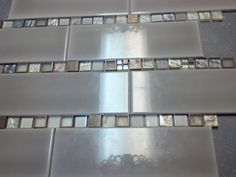 Picture 17... Sample of backsplash.  Great way to save money is to mix on sale tiles with a higher end accent tile.  In our case our subway tile, great price.  added a higher end mosaic tile and cut it into strips to make it more cost effective.