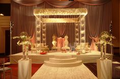 Tall floral mandap with levels of candles and floral pomanders. #wedding #Indian #ceremony #roses #flowers