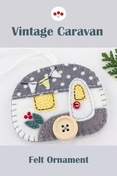 Handmade in grey and white felt with red details, this hanging vintage trailer ornament has a button wheel and door knob, and tiny bunting flags.With blanket stitched edges and a cotton loop for hanging.The ornament is flat in shape, with a plain felt back.Size approx 3 x 2.5 inches / 7.5 x 6.5 cm. #feltchristmasornaments #vintagecaravan #vintagetrailer #feltornaments Scandi Christmas, Vintage Caravans, Bunting Flags, Felt Christmas Ornaments, Blanket Stitch, Door Knob, Handmade Felt, Hand Stitching, Grey And White