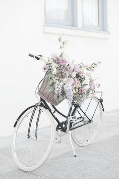 Black bike style with white wheels and woven basket. See more stylish women on bikes at melisinestudio.com and @melisinestudio on instagram.