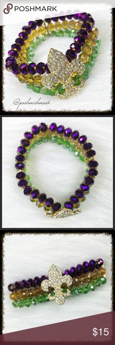 "Mardi Gras Fleur de Lis Stretch Bracelet Green, gold, and purple Mardi Gras stretch bracelet with rhinestone Fleur de Lis. 7"" unstretched. ✅MAKE OFFER✅ Jewelry Bracelets"