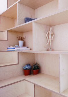 Plywood shelving built along staircase