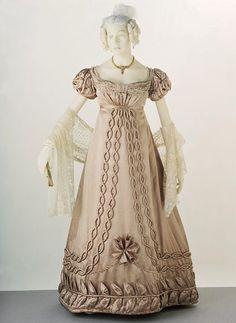 Ball Gown circa 1820-1823. Possibly French or English. Silk satin, trimmed w/ silk satin & silk bobbin lace.  Via V&A
