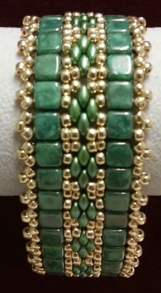 """This 7 3/4"""" bracelet is handcrafted using 6mm Czechmate Chech Glass Tile Beads (color: Honey Dew Moon Dust), Super Duo Chechmate Chech Glass Beads (color: Olivine Pearl), and #8 Starlight Glavanized Perma Finish Toho Seed Beads."""