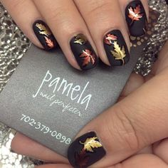 Glimmering metallic leaves on matte black polish is simple and stunning.