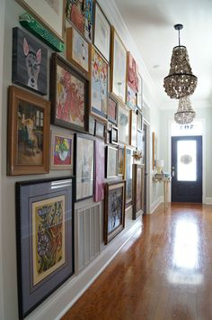 """We all are pretty familiar with the """"gallery wall"""" but what about a full on """"gallery hall?"""" This New Orleans home belongs to Kellie and Marc (my sister and brother-in-law) w…"""