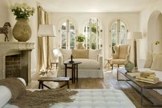 Wondrous space.......textiles, metal, light, the chaise & yes a fireplace......ahhhhhh....pamela pierce 10